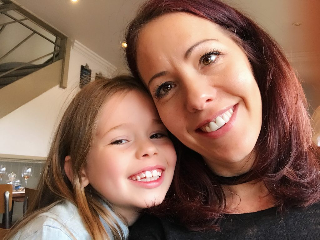 mum and daughter smiling and having a cuddle. Social media does not show the full picture, that they have just dosed up on pain meds