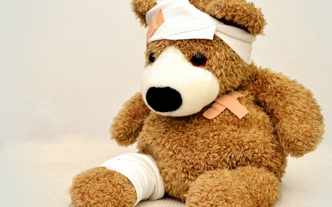 teddy with bandaged and plasters because he is in pain